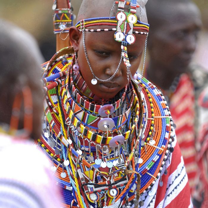 Maasai bride Namunyak Baiera wears traditional bead necklaces during her wedding in Olepolos village, 120 km (74 miles) southeast Nairobi, March 31, 2007. In the Maasai tradition the groom has to pay for his bride in cows and sheep, which have to be brought to her family on the wedding day. REUTERS/Damien Guerchois (KENYA) - RTR1ODTF